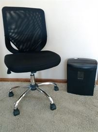 Office chair and paper shredder