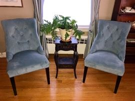 Microsuede chairs with stenciled occasional table.