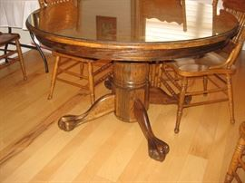 Oak Claw Foot Table with Three Leaves and Eight Chairs...