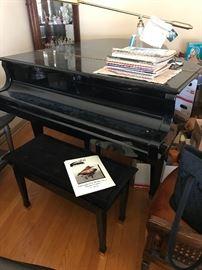 1995 black lacquer Wurlitzer baby grand piano model G-457; includes bench and piano lamp - $3000.