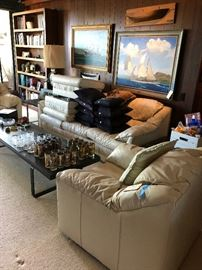 White leather sofa - (Sold) and 2 chairs, slate and iron coffee table - 2 side tables - Ship painting on the left has sold.  Loads of barwear and nautical items