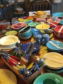 Lots of Fiesta dinnerware and serving pieces