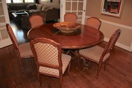 Round dining table (great for conversation) with 6 chairs