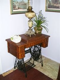 One of several antique sewing machines - check out the banquet lamp on top!