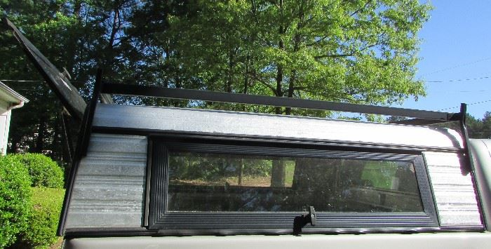 6' GM/Chevrolet Camper Shell with ladder rack on top. In very good condition. Item will not be at the sale during the sale for you to physically see. Item will be available to see or pick up on Sunday, June 24. Contact me if interested.  Interested buyer can pay at sale.