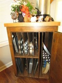 Butcher block cabinet with dividers for pan storage.