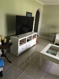 Tv spoken for but the cubby hole stand, antique table with minions, coffee table and end table for sale.