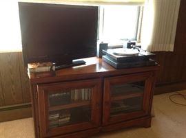 Flat screen TV, Denon turntable / receiver, entertainment cabinet