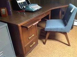 Vintage mid century desk, new moderne teal chair, vintage manual typewriter.