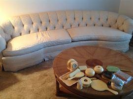Tufted sofa , vintage dresser pieces.
