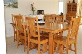 Amish made White Oak Dining Table with 2 Leaves (not shown) and 6 Chairs.  In Excellent Condition