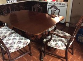 Dining room table & 6 chairs(2 are captains) has one leaf and pads for all
