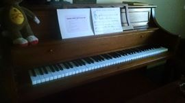 Thomas brand upright piano.