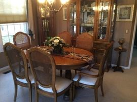 DINING ROOM TABLE WITH 2 LEAVES AND 6 CHAIRS ALSO THE CHINA CABINET IN THE BACK THAT IS FULL OF SMALLS