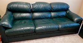 STRETCH OUT ON THIS MATCHING GREEN LEATHER COUCH