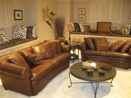 Safari-themed family room, leather sofa and loveseat, animal print pillows