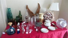 Unique figurines, lanterns and lamps. glass bottles, vases jars
