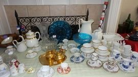 Tea pots, coffee pots, pitchers, cups and saucers, desert sets, plates, trays, bowls, hostess sets, platters