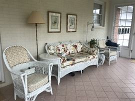 Lots of white wicker furniture