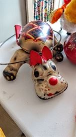 Vintage metal dog toy with handle that makes his feet move