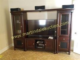 "Large TV cabinet, 65"" Sony LED smart TV"