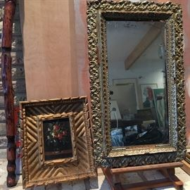 Vintage and antique gold mirror frame and artwork