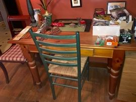 kitchen table with one drawer used as desk and two kitchen chairs