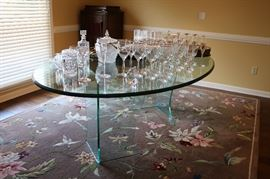Love this glass table.  Any chairs would compliment it. The rug is lovely also.