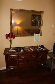 Small amount of jewelry. Big mirror. Side chest like a buffet. Or stand for flat screen TV