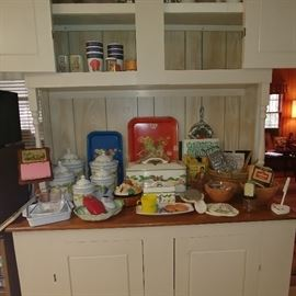 A kitchen full of vintage goodies glassware Tupperware vintage pots and pans