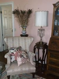 Wing back chair, marble top plant stand,  and crystal lamp