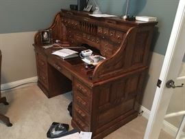 Rolltop desk with printer and keyboard drawers and circuit breaker