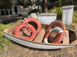 Fiberglass - mahogany made in 1968 in LA (costa Mesa? Newport? ) It has a brass plate that says where it was made and the date. Dingy - Slip and Life Tings