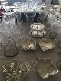 Top: Gondola bowl; Crystal vases & silver serving dishes