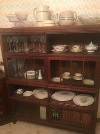 Century old, 4 individual book/display cases stacked on top of each other, from Switzerland.  Excellent condition, each section about 4' long and 2' tall.  glass is in great condition as well.  Beautiful piece!