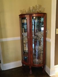 Antique curved glass hi a cabnet