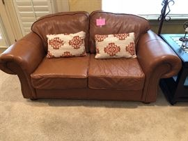 Matching leather loveseat with nailhead trim