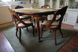 Mahogany Table with leaves and 8 chairs with rose carvings