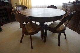 Beautiful antique dining table with 8 chairs