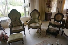 Victorian tufted high backed arm chairs with footstool.