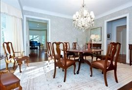 Beautiful rug, spectacular crystal chandelier and maple dining room