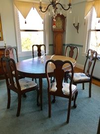 American, late 20th century, Italian style dining table.  Top features inlaid band of satinwood.