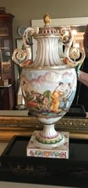 An Italianate lidded urn circa