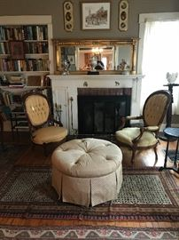 Victorian Living Room at the farm house, his and her side chairs and a round ottoman, great rugs and above the fireplace an Empire mirror circa 1860