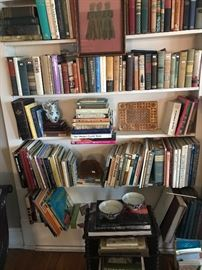 A collection of books and vintage music.  Notice the headstone rubbing from England and the gold leaf cover of a Russian book