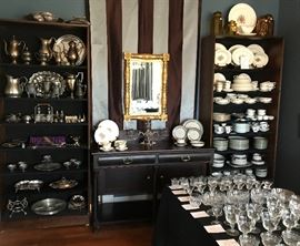 The Dinning Room 24K mirror circa 1840 American Empire sideboard circa 1830 Several sets of china, crystal stemware, and a large selection of Victorian Silver