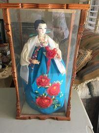 Glass encased Japanese doll