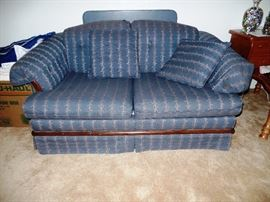 One of two comfortable love seats