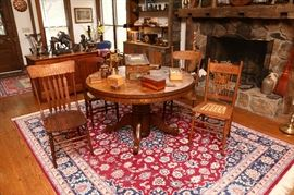 Round oak table, assorted chairs, collection of wooden b oxes.