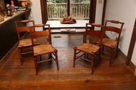 Enamel top table with set of four vintage chairs with rush seats.